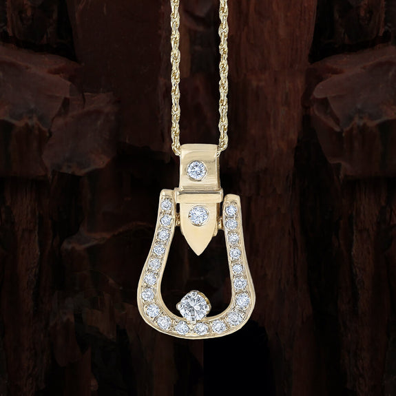 Diamond Western stirrup pendant in yellow gold by Lesley Rand Bennett