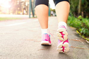 Woman in tennis shoe walking for exercise