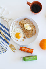 Toast with egg and Balance the Superfood Shot Foundation and Turmeric Blend