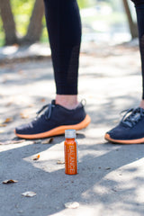 Running shoes with Balance the Superfood Shot Turmeric Blend