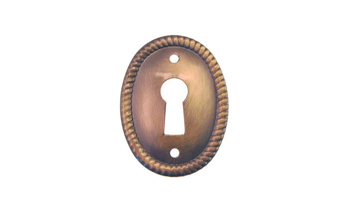 Stamped Brass Vertical Oval Keyhole ~ Antique Brass Finish