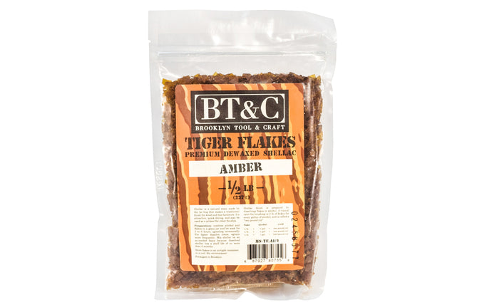 Dewaxed Amber Shellac Tiger Flakes - 1/2 lb Bag - Refined in Germany ~ once dissolved in alcohol, will make a beautiful finish for woods, cork, plaster, & metals. They are refined for a clear finish. Great for French Polishing - De-waxed Amber flakes