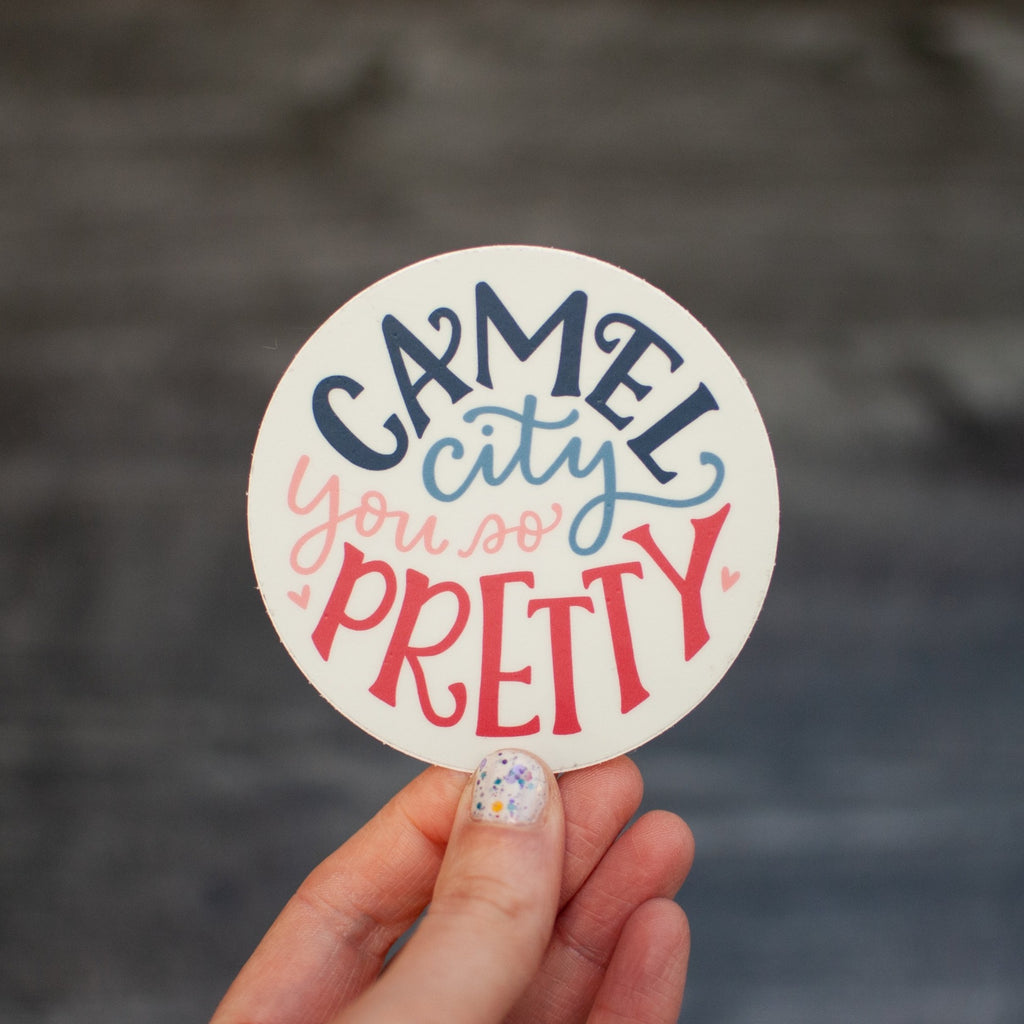Camel City, you so pretty. Hand-lettered design by Em Dash Paper Co. Round, 3-inch diameter, weather-resistant vinyl.
