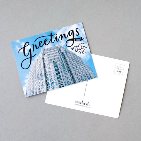Greetings from Winston-Salem, NC. Postcard by Em Dash Paper Co, featuring the iconic downtown Wells Fargo building.