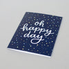 Navy blue card with confetti and modern calligraphy by Em Dash Paper Co. Oh happy day!