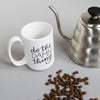 The perfect companion for your morning coffee, this mug will remind you to do the damn thing. White ceramic and holds 15 oz. By Em Dash Paper Co.