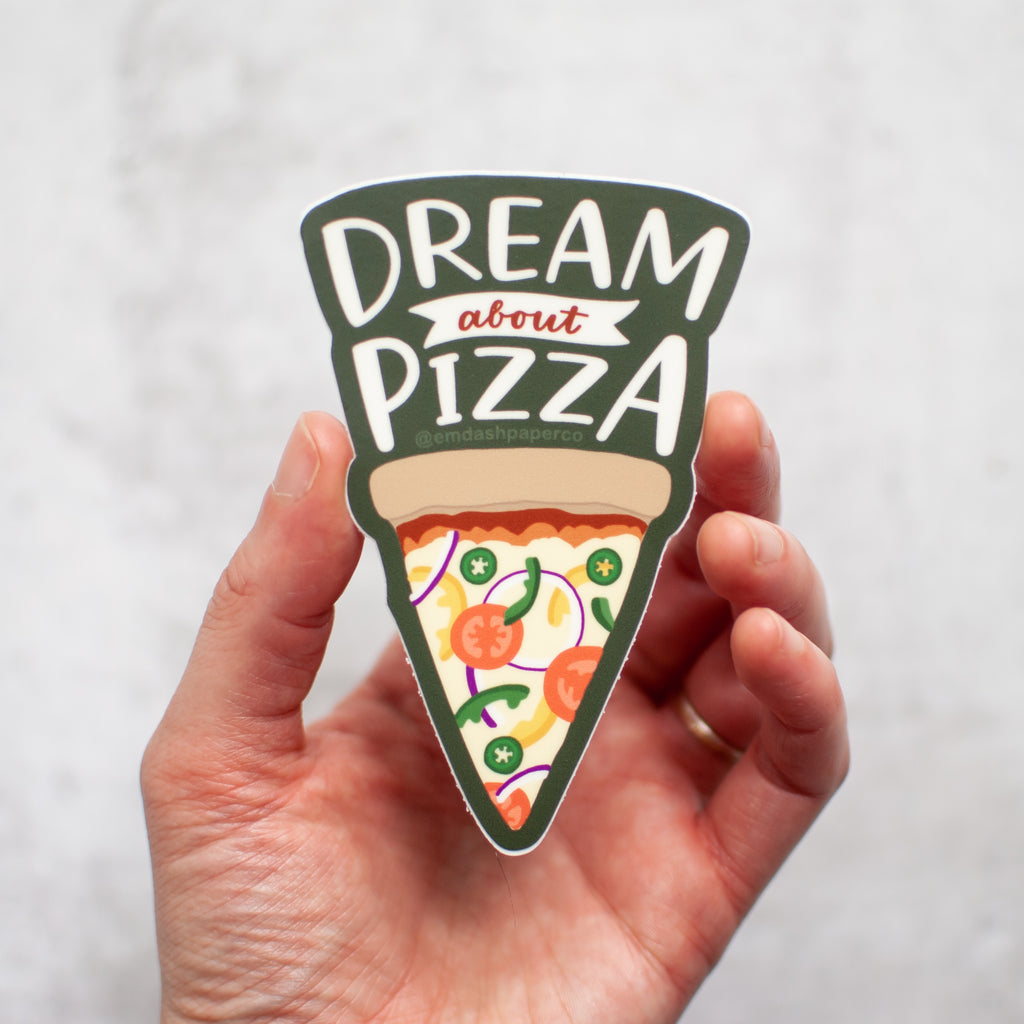 Dream about pizza! Vinyl sticker with hand lettering and an illustrated slice, by Em Dash Paper Co.