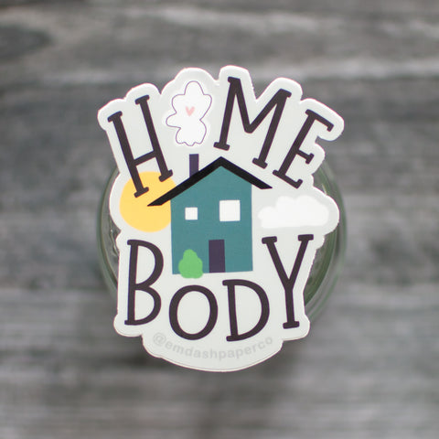 Home body vinyl sticker for all the introverts out there. Featuring playful hand-lettered serif text and a cute little house illustration. By Em Dash Paper Co.