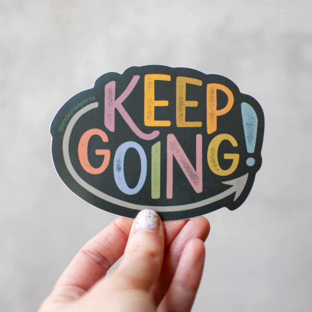 Keep going! Hand-lettered sticker in weather-resistant vinyl. Designed by Em Dash Paper Co and printed locally in Winston-Salem, NC.