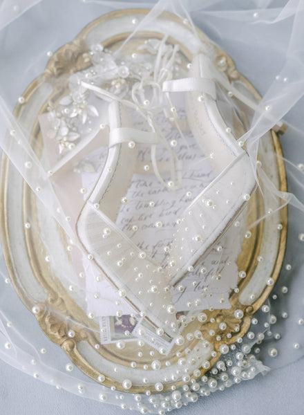 Wedding shoes and pearl veil