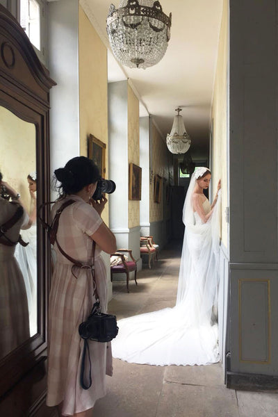 Amelia Soegijono photographing a bride wearing Madame Tulle Juliet cap veil