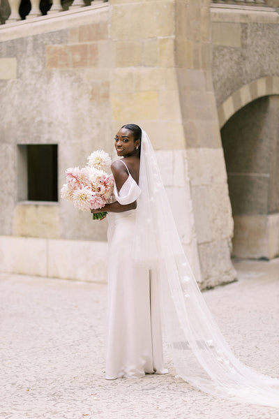 A bride wearing a wedding veil with flowers
