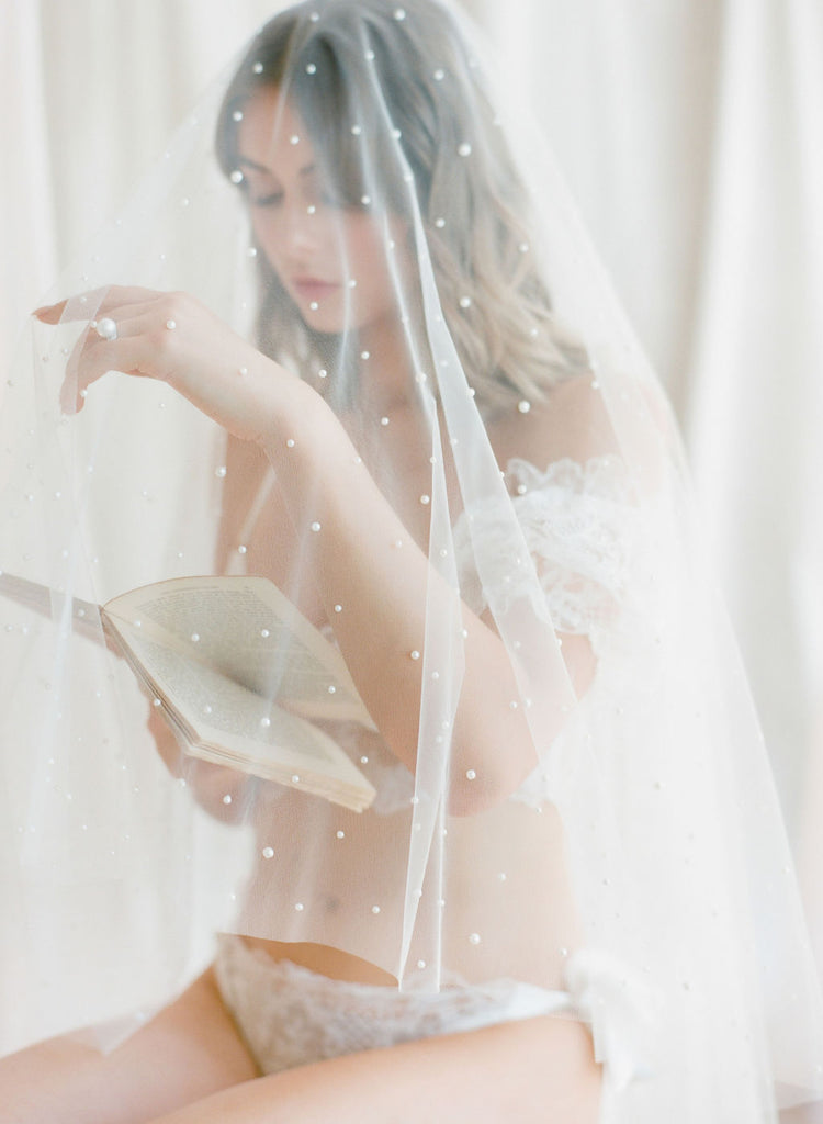 A bride wearing pearl wedding veil by Madame Tulle