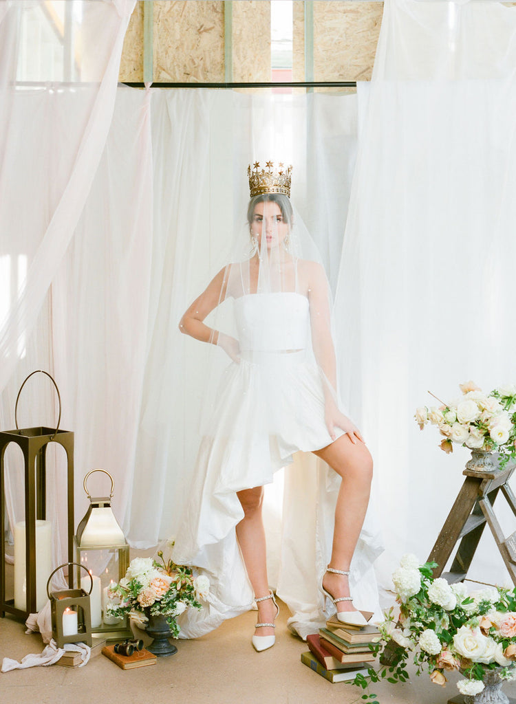 A bride wearing crown and pearl wedding veil by Madame Tulle