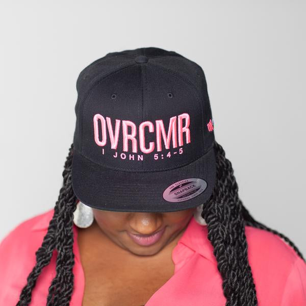 Mandisa Black OVRCMR 1 John 5:4-5 Hat With Pink Text
