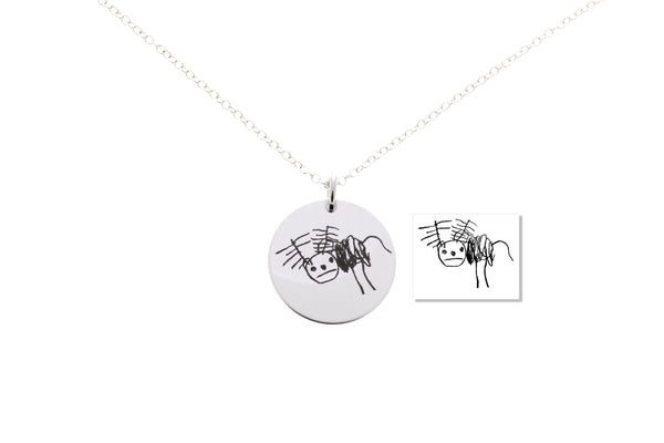 kids drawings engraved onto necklace
