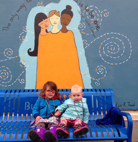 My daughter and her buddy on the bench in front of my mural