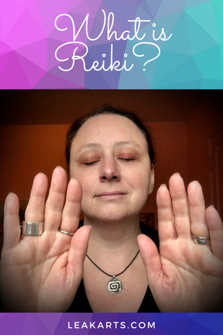 """A smiling woman with her eyes closed and her hands held up in a gesture of sending energy.  There is text above her that reads """"What is Reiki?"""" and text below her says LeaKArts.com"""