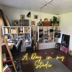 "The interior of an art studio lined with shelves for supplies and paintings.  Text reads A Day ""in"" my Studio."
