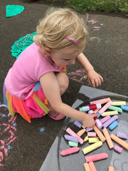 My daughter playing with sidewalk chalk