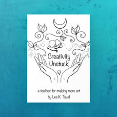 Creativity Unstuck: a toolbox for making more art book by Lea K. Tawd. Image shows book title, two hands with a heart between them, flowers and vines flowing between the hands, and an crescent moon at the top.  The illustration is black and white on a field of teal blue.