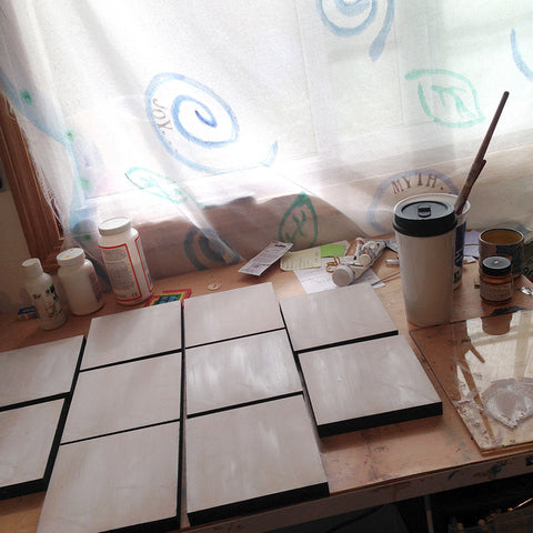 studio drawing table with canvases being prepared