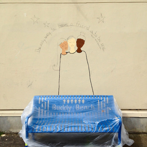 start of mural behind buddy bench at buckman elementary in portland, or