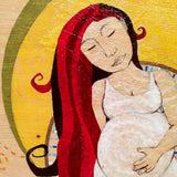 pregnant woman with red hair and eyes closed