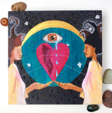 Painting on wood panel of a black woman and a white woman with a heart, a crying eye, a crescent moon, a large blue clock face, and silvery moths. By Portland artist Lea K. Tawd.
