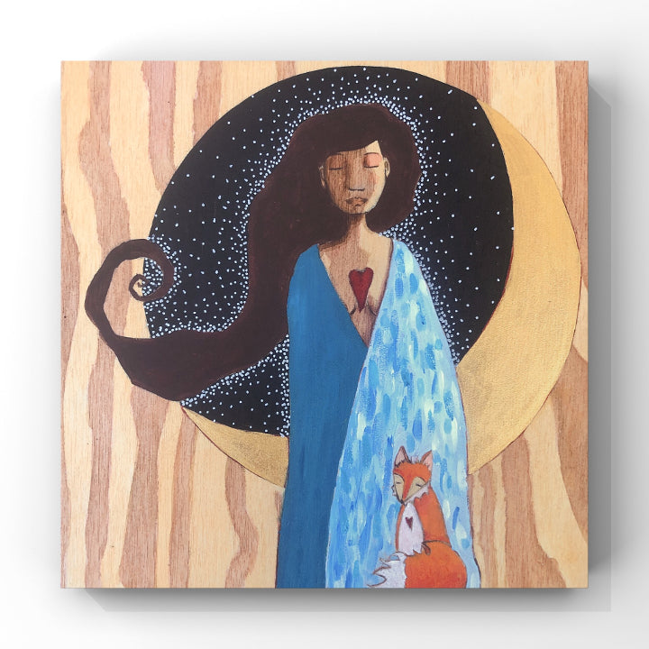 print of blue-robed woman and her fox companion standing in front of a golden crescent moon.