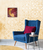 small feminine painting hanging on the wall above a blue chair