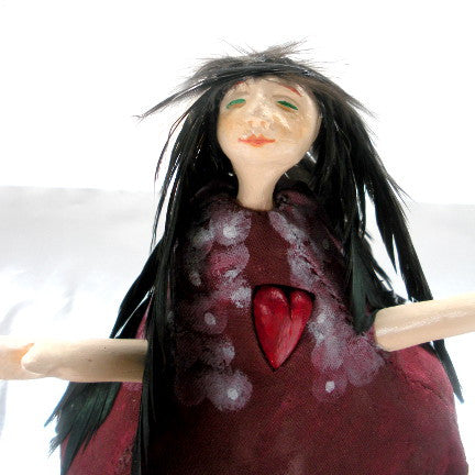 Portrait of red art doll by Lea K. Tawd
