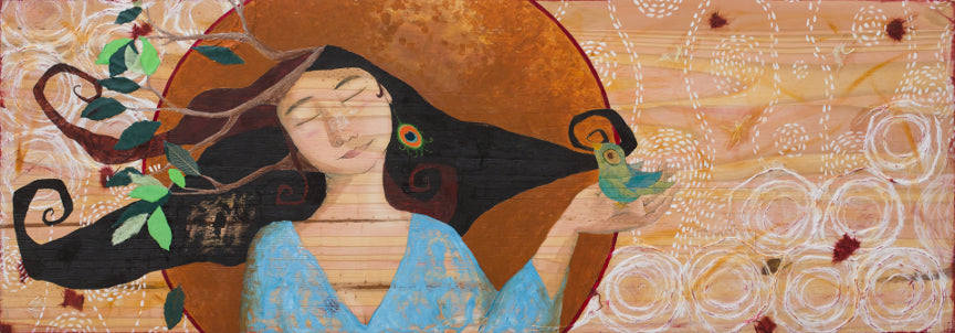 mixed media painting on natural wood showing a woman with dark curly hair and branches growing from her head. She is wearing a light blue textured sweater and a peacock feather earring. She is holding a pearlescent blue green bird in one hand.  She has a large warm toned circle behind her head.  Beyond the circle is collaged white paper and mark making.