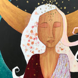 detail of goddess art showing wood grain and collage