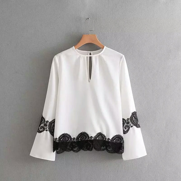 Elegant Black and White Blouse