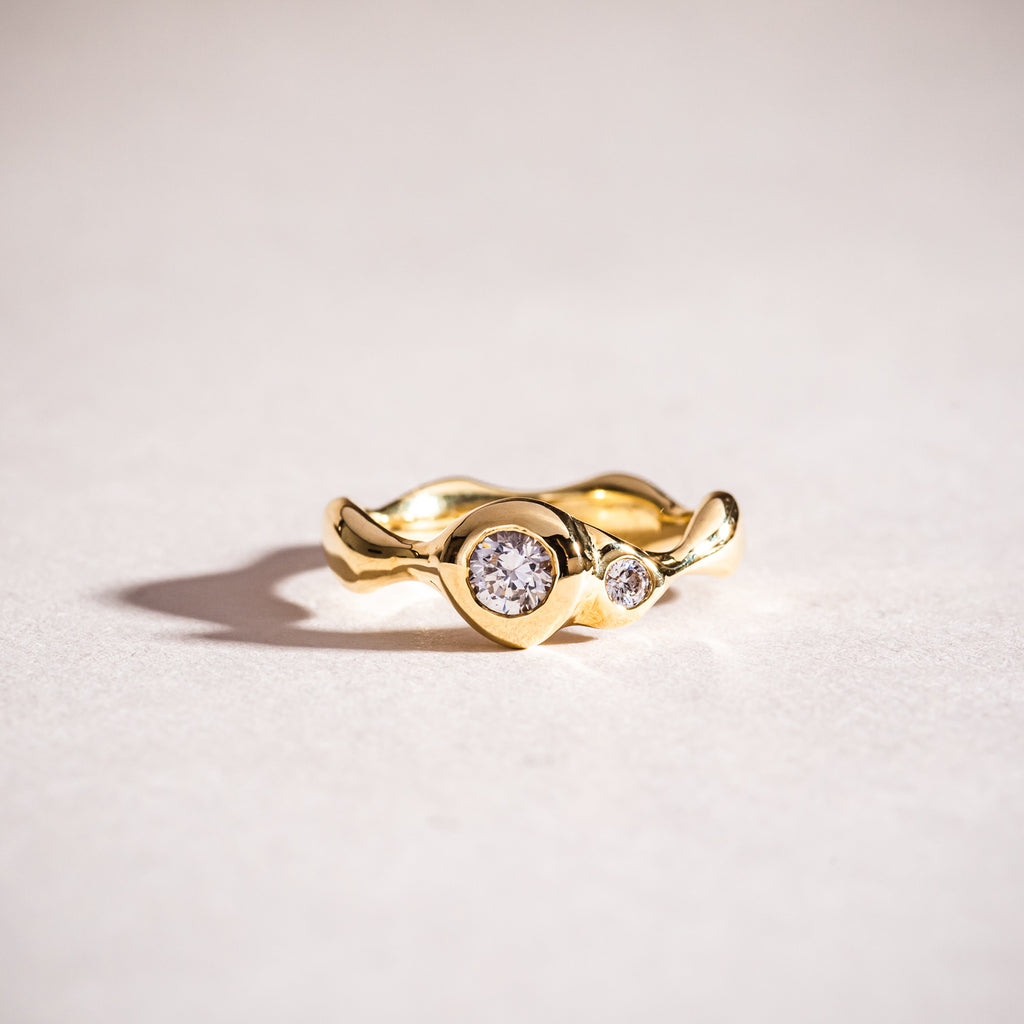 Polished wavy gold and diamond ring
