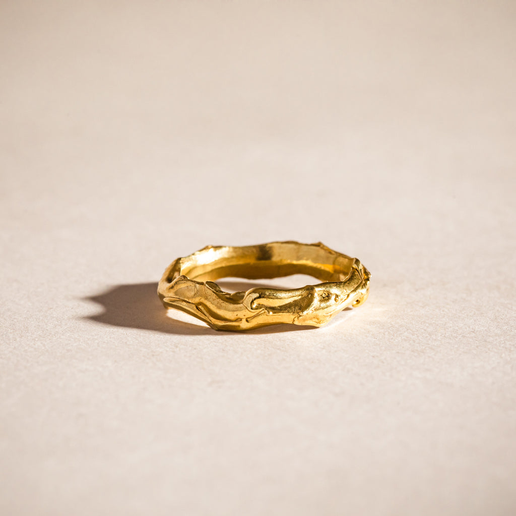 Textured, organic wavy 18ct yellow gold band