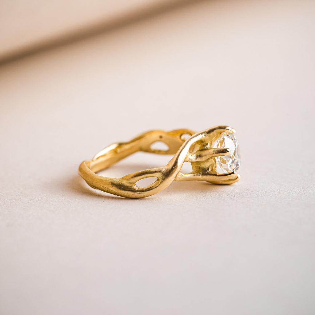 Organic branch like entwined 18ct yellow gold ring that weaves around a Canadian brilliant round diamond