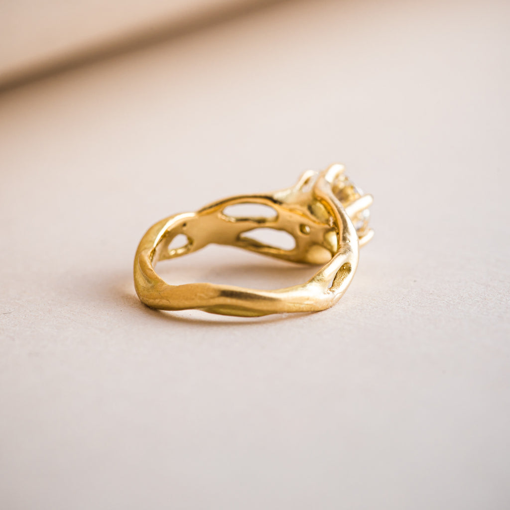 18ct yellow gold branch like ring with a band that mimics nature and branches.