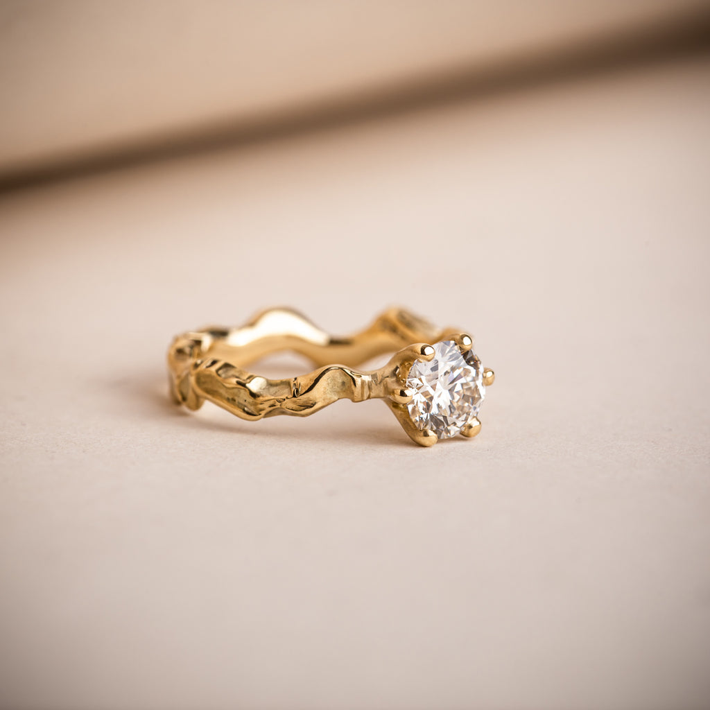 Sculptural and textured wavy 18ct yellow gold engagement ring with Canadian brilliant round diamond