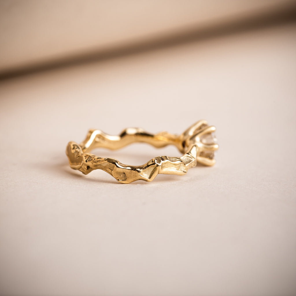 Wavy and sculptural 18ct Fairtrade yellow gold engagement ring