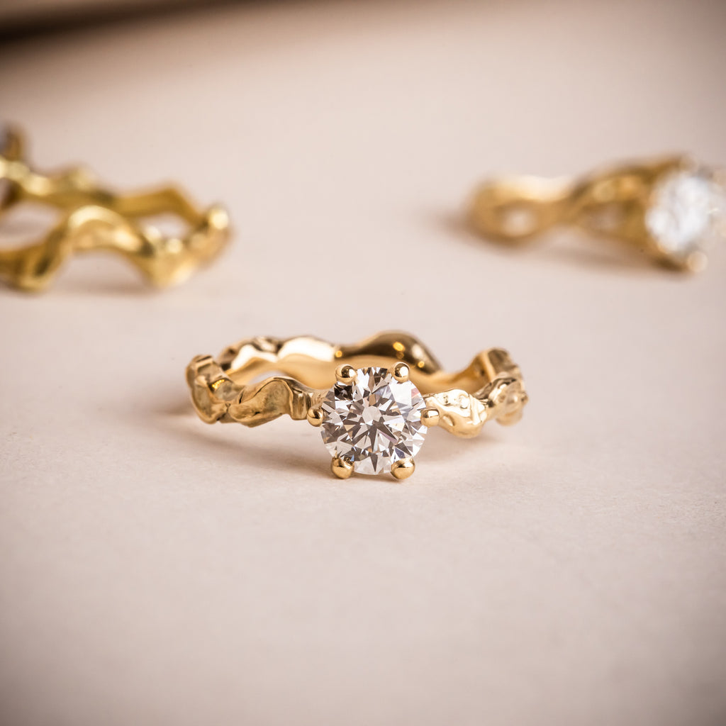 A selection of sculptural 18ct yellow gold engagement rings with Canadamark Canadian diamonds