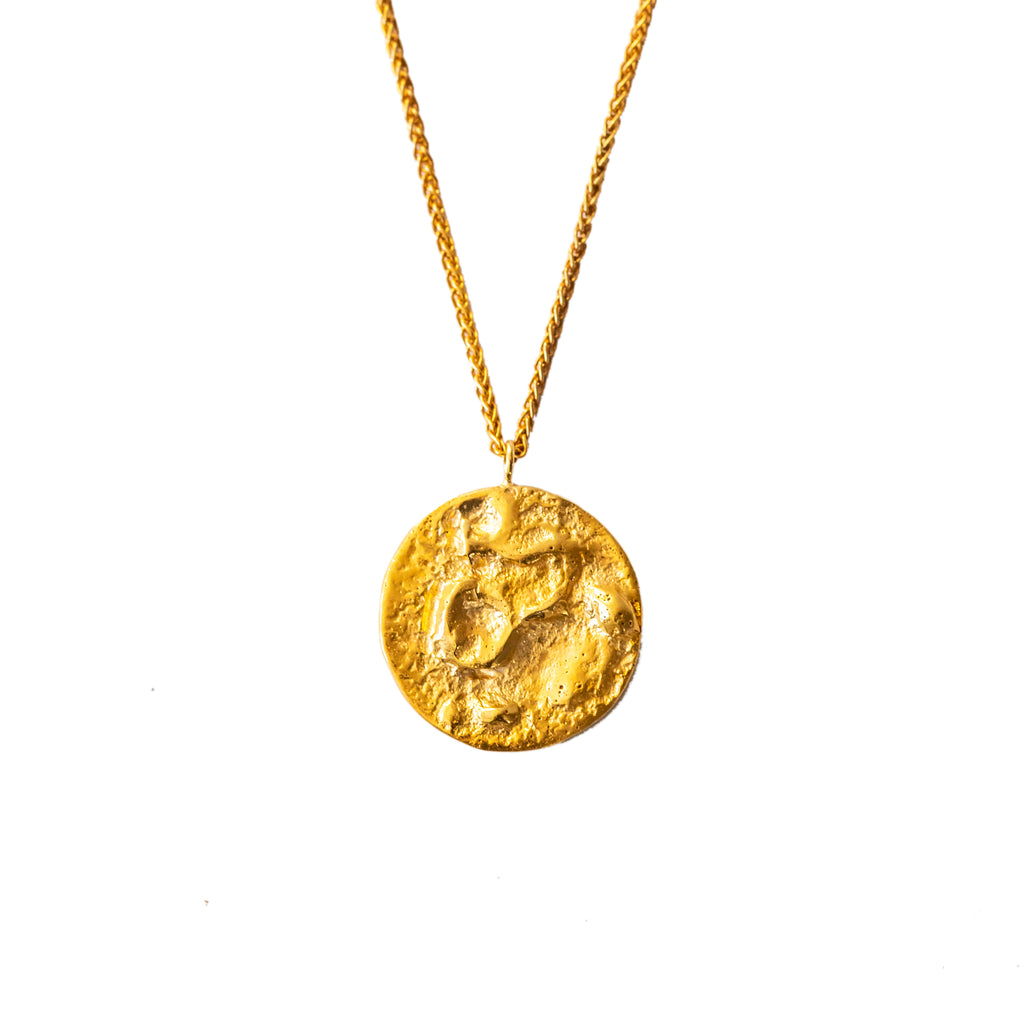 Textured 18ct gold moon pendant