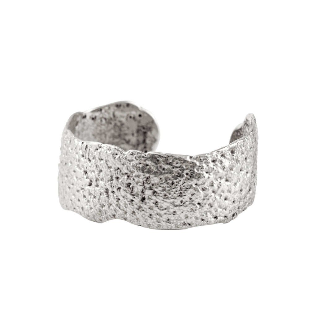Dappled and textured recycled sterling silver cuff bangle