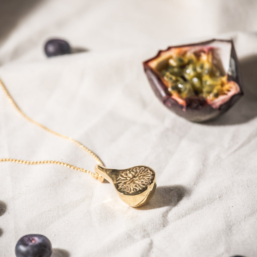 18ct Fairtrade gold fig necklace, hand carved in London
