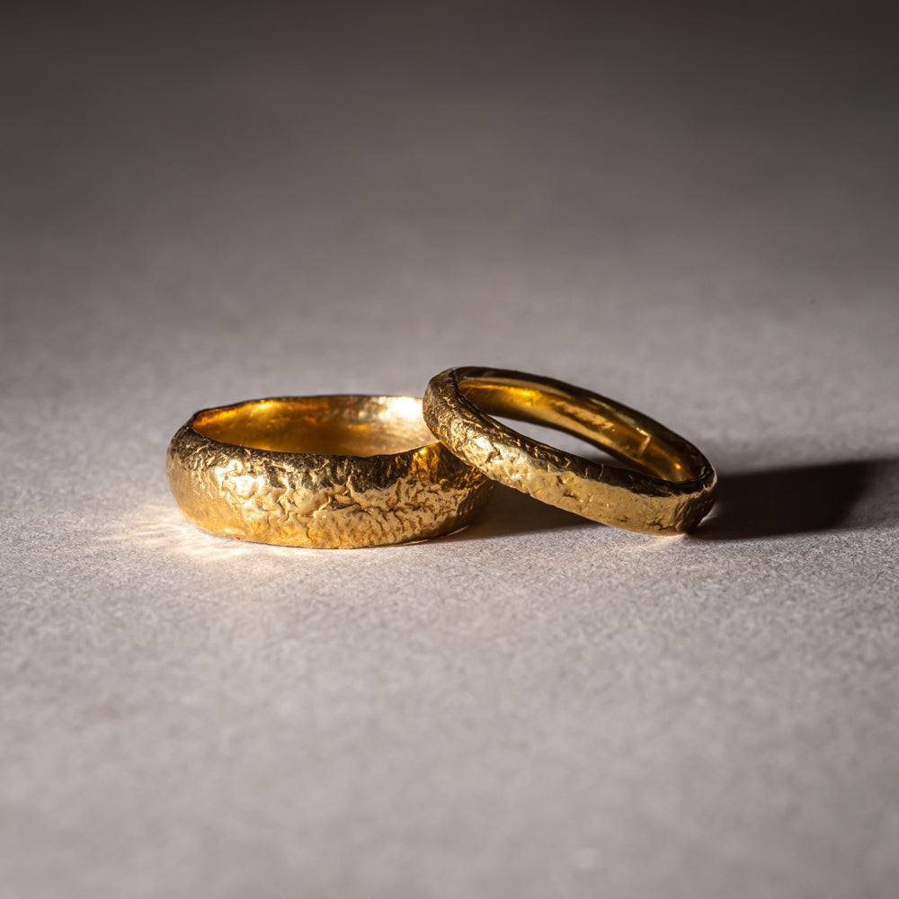 Fairtrade yellow gold wedding rings with texture