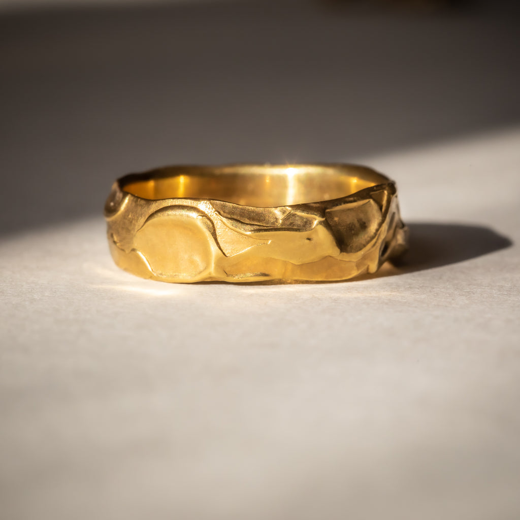 Unusual textured wide yellow gold wedding band