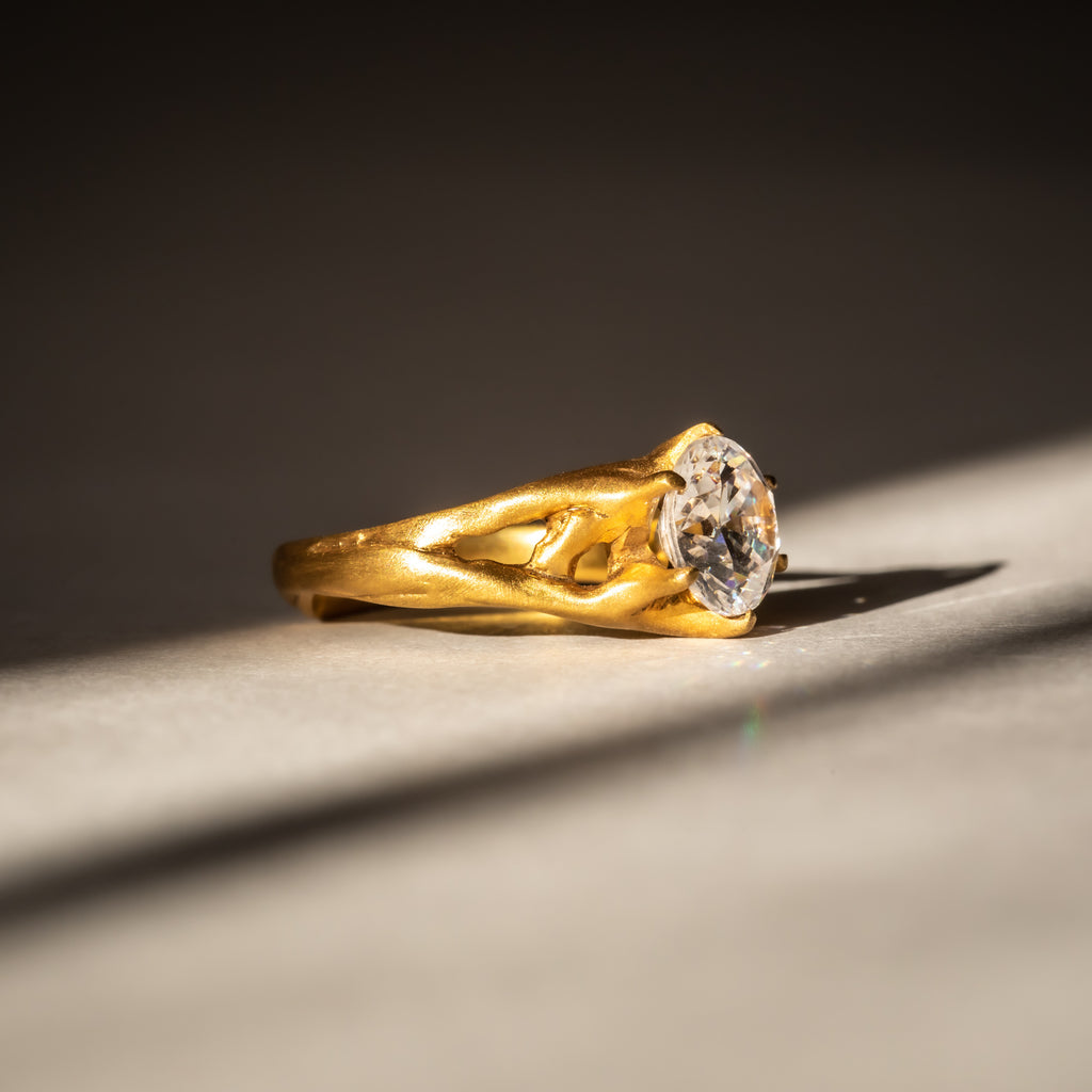 Ethically handcrafted engagement ring in 18ct Fairtrade Gold and ethical diamond