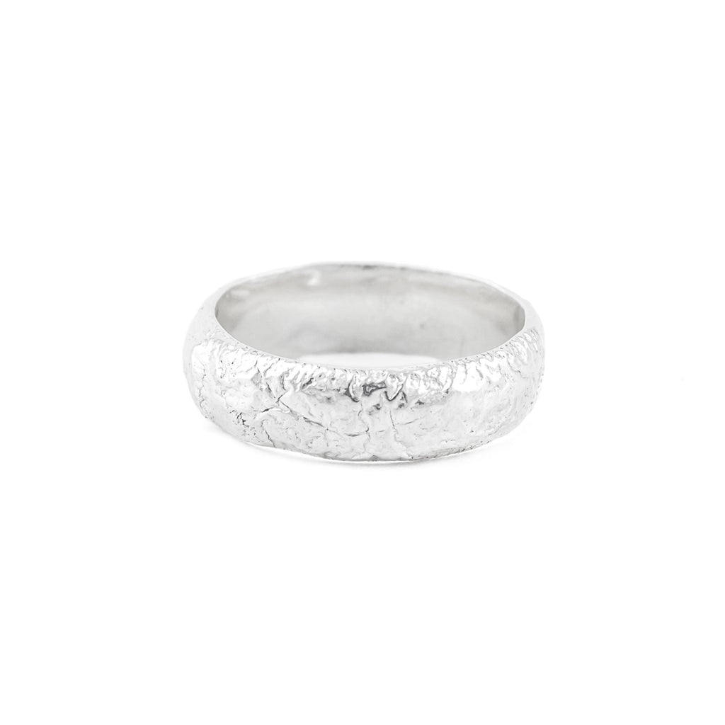 Handcrafted textured silver wedding band