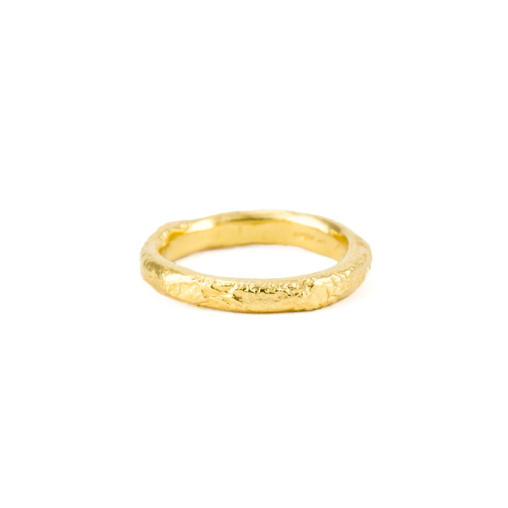 Simple handcrafted yellow gold wedding band